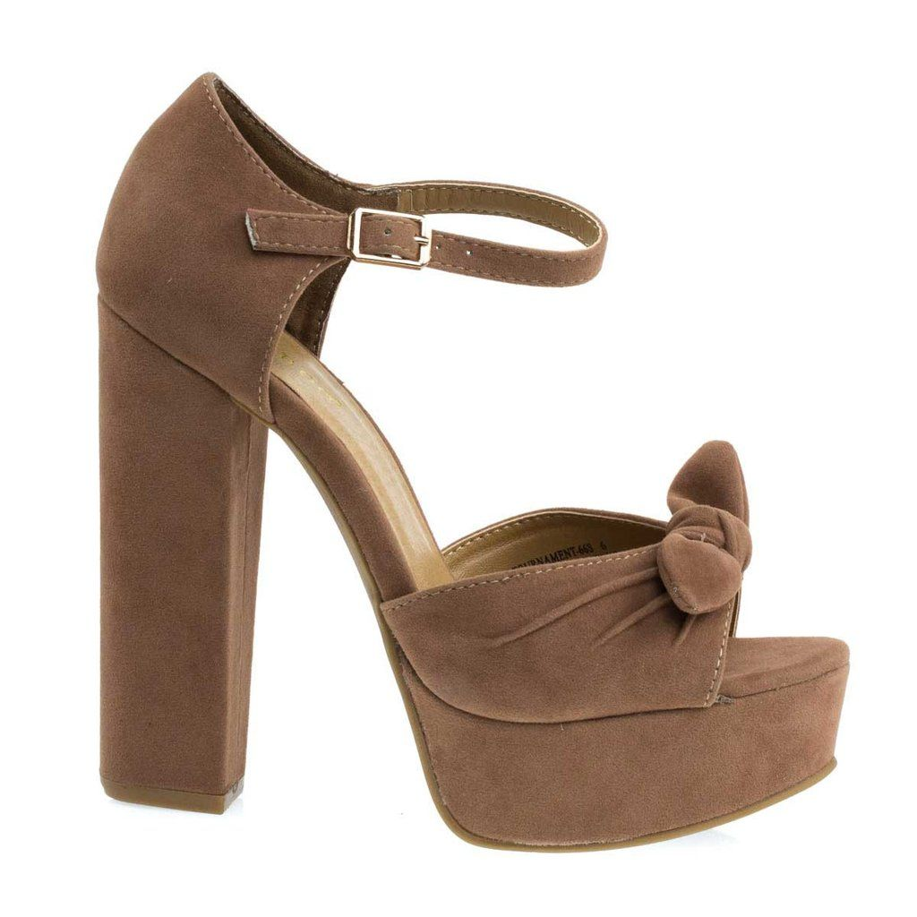 0fcf71f05ce Grace the dance floor with these impressive towering block heel sandal  featuring front bow ornamentation