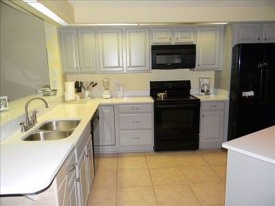 gray cabinets with cream counters