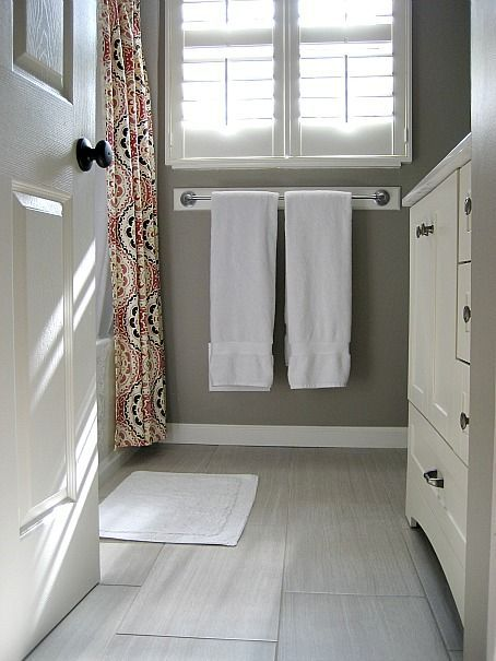 a light grey 12 x 24 tile in the bathroom and kitchen would be nice