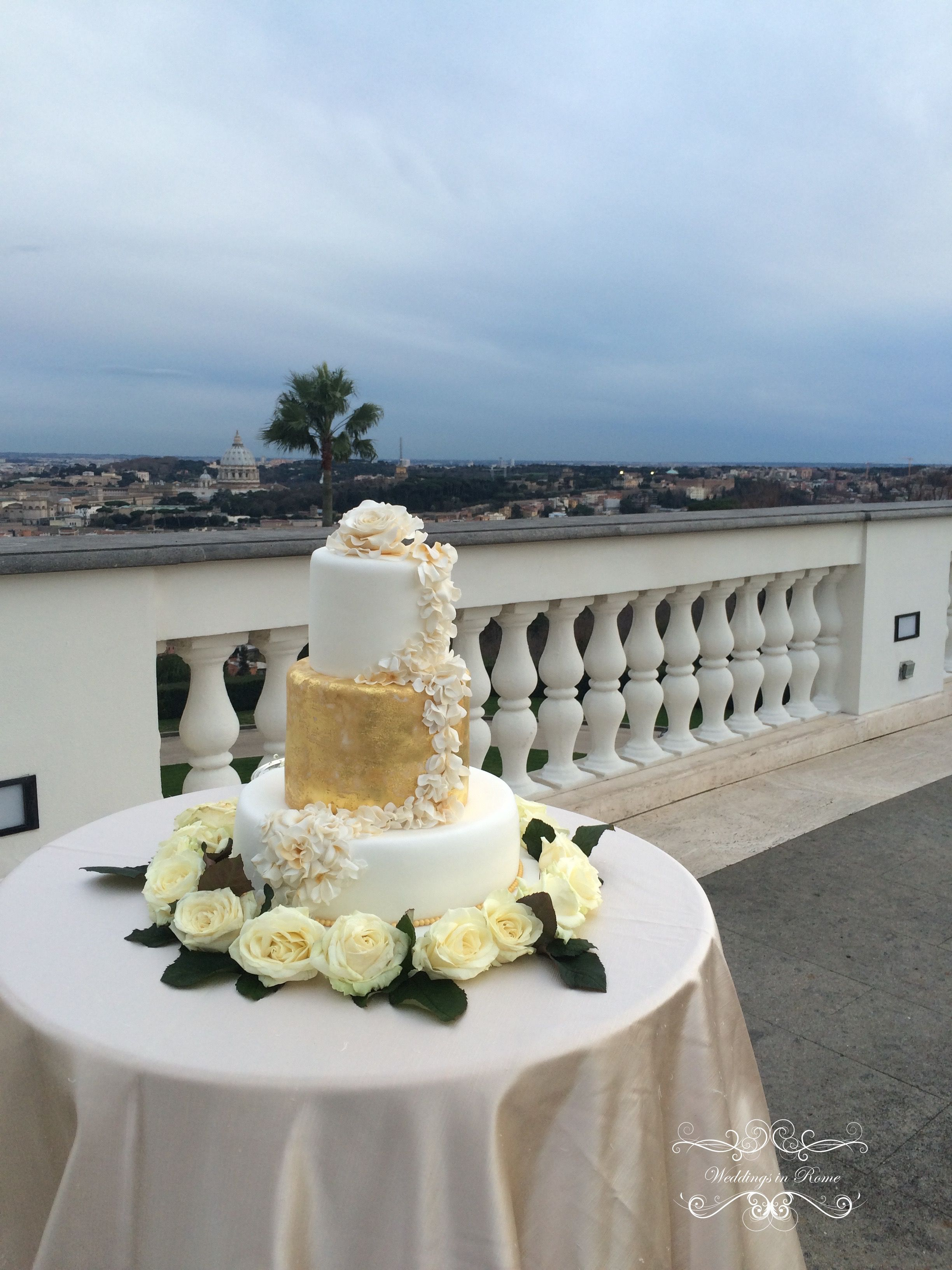 Tri and Rae's beautiful gold leaf cake. Our couple from Indonesia at their spectacular venue with view in Rome www.weddingsinrome.com