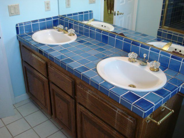 Notice how the floor tile is fighting with the vanity tile? Throw in the cabinet, and you can understand why these folks wanted to update their hall bath!