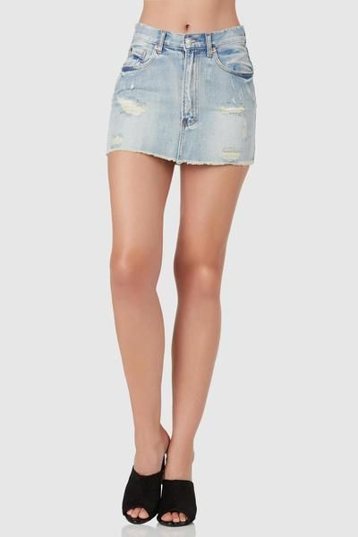 1dfc1c748e0a Casual denim mini skirt with vintage style wash and distressed detailing. 5  pocket design with button zip closure and raw hem finish.