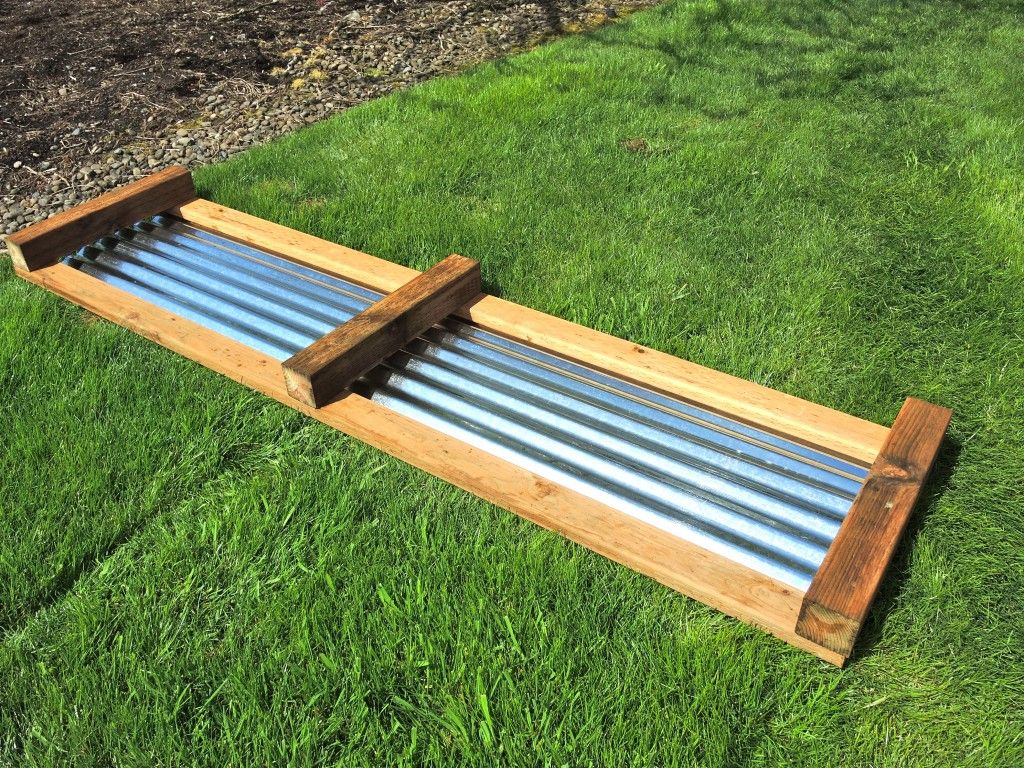 Galvanized raised beds side of the frame and the positioning of the galvanized metal piece for Corrugated metal raised garden beds