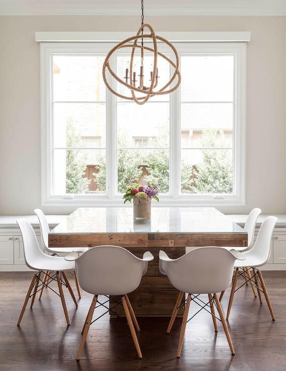 Superbe Contemporary Dining Room Features A Rope Sphere Chandelier Hanging Over A Square  Wood Dining Table With Glass Top Lined With Eames Molded Plastic Armchairs.