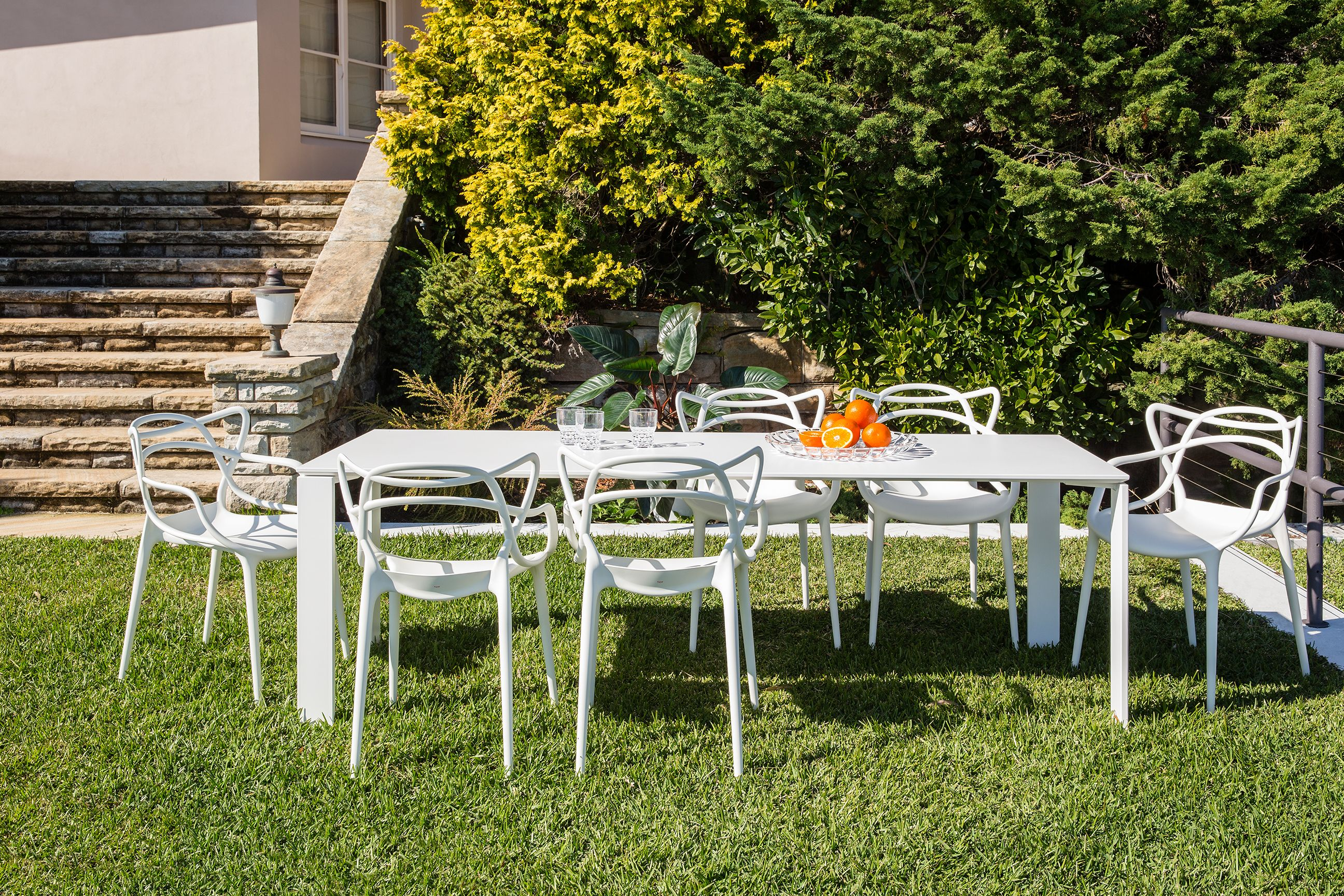 Kartell Masters dining chairs Kartell Four Outdoor table Kartell