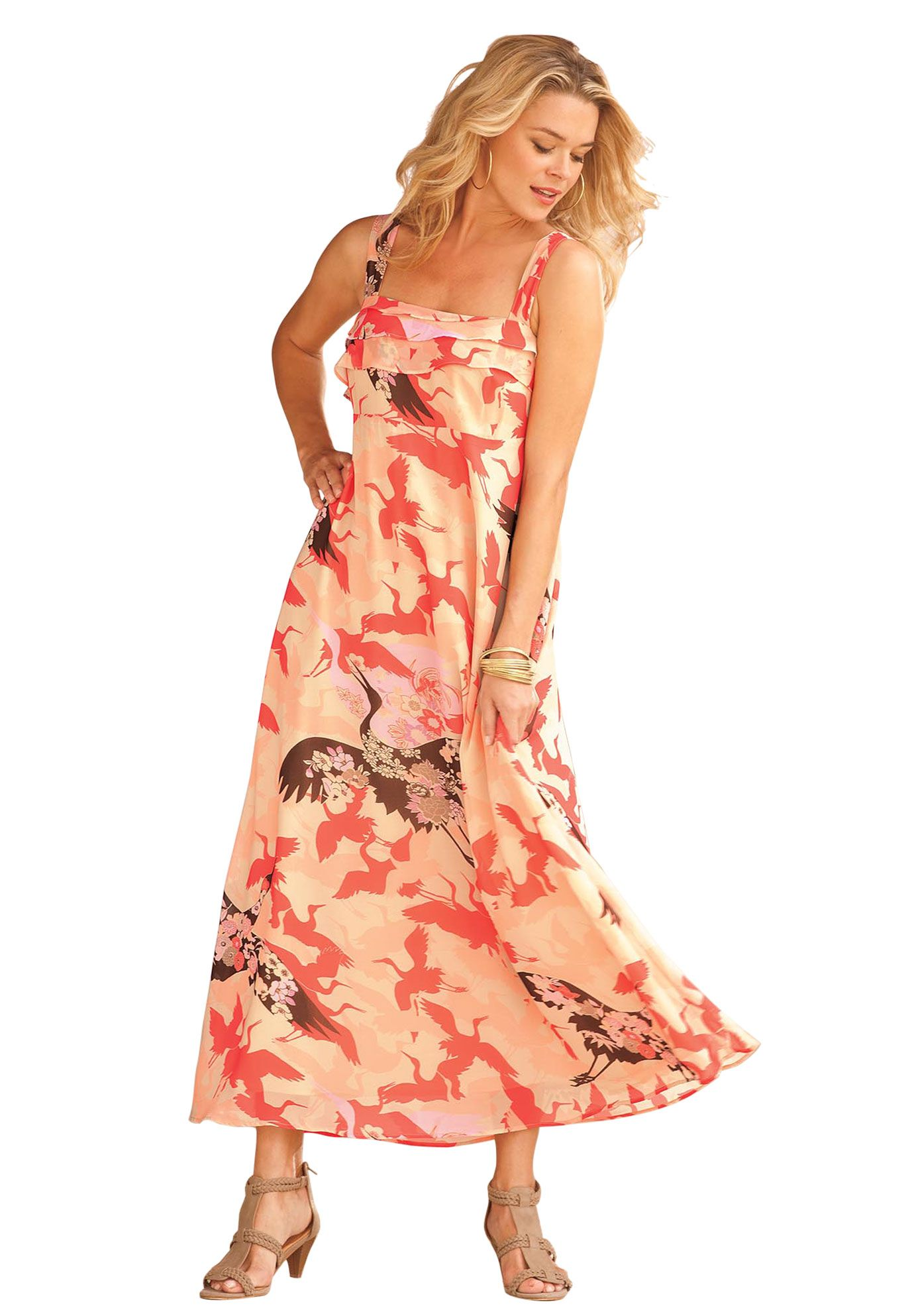 This printed plus size dress with flattering empire waist glides