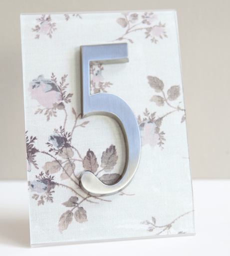 DIY : Table Numbers Using House Numbers  Instructions: http://merrybrides.tumblr.com/post/23856401919/tablenumbers