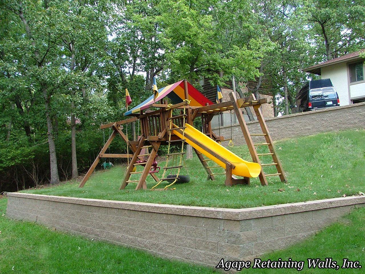 swingset on sloped/retaining wall yard   Backyard ... on Retaining Wall Ideas For Sloped Backyard id=38687