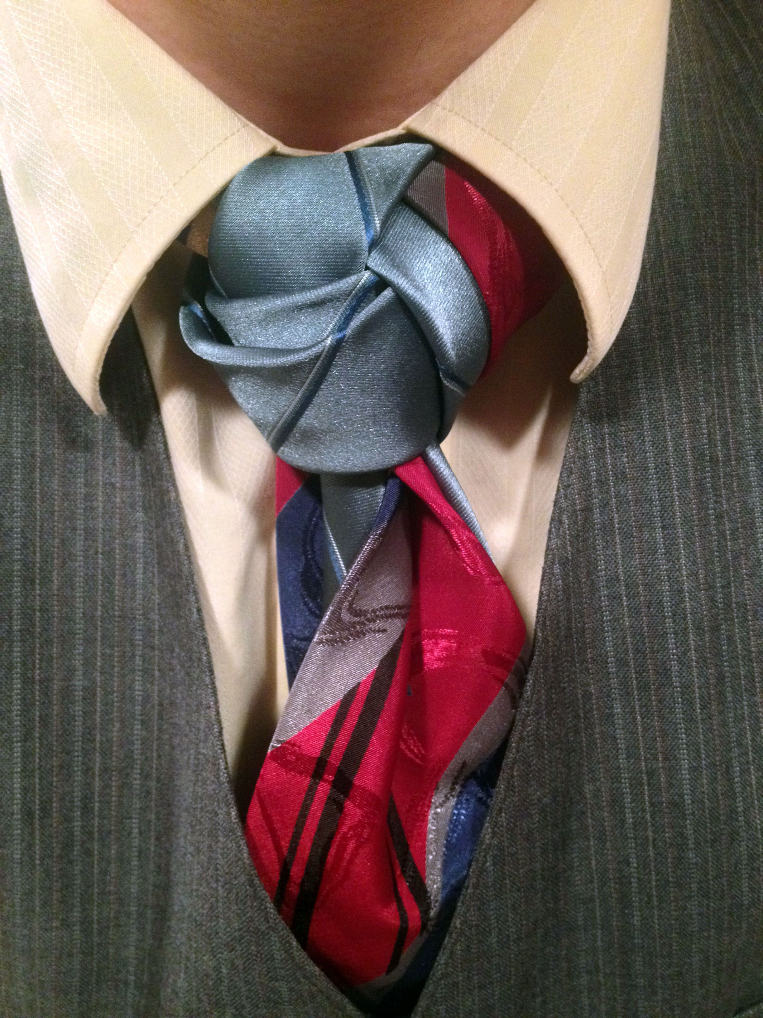 I'm not sure if I like the knot or the way the ties flow out directly below it…