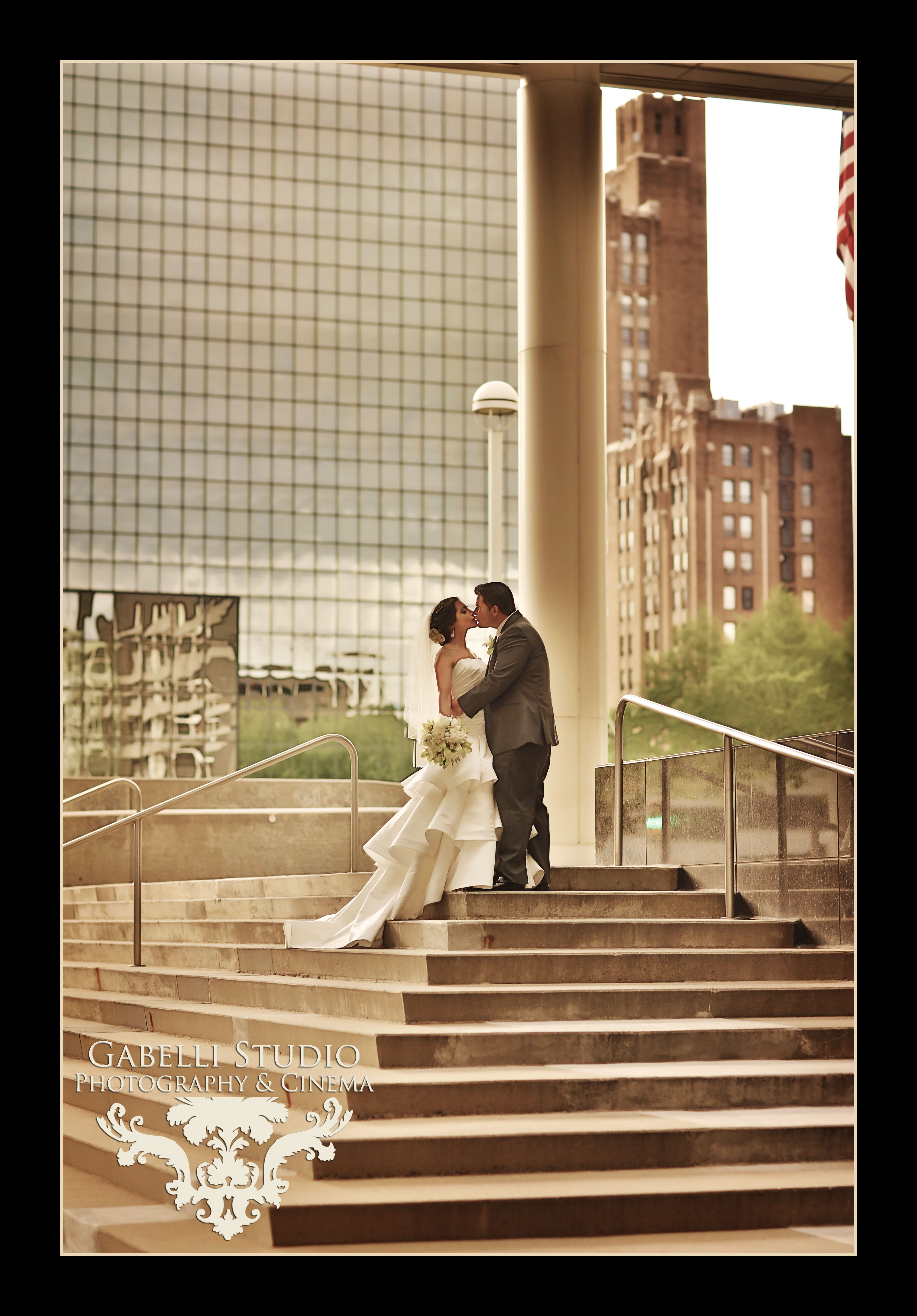 Bride and groom in front of the metropolitan room at the