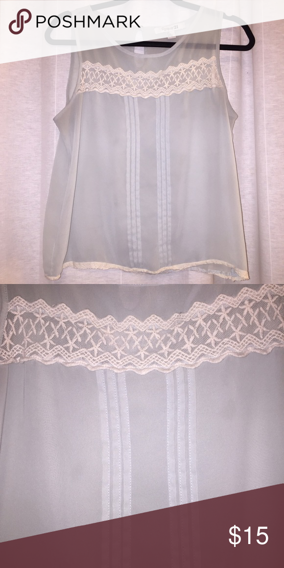 Sheer Mint & Cream Lace Panel Blouse This is a sheer blouse with a mint tint and cream lace panel across the front and hem. It looks beautiful with a lace bralette underneath. Forever 21 Tops Blouses
