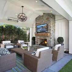 Wicker Outdoor Sofas And Chairs With Navy Trellis Pillows Transitional Deck Patio Outdoor Fireplace Designs Patio Fireplace Patio