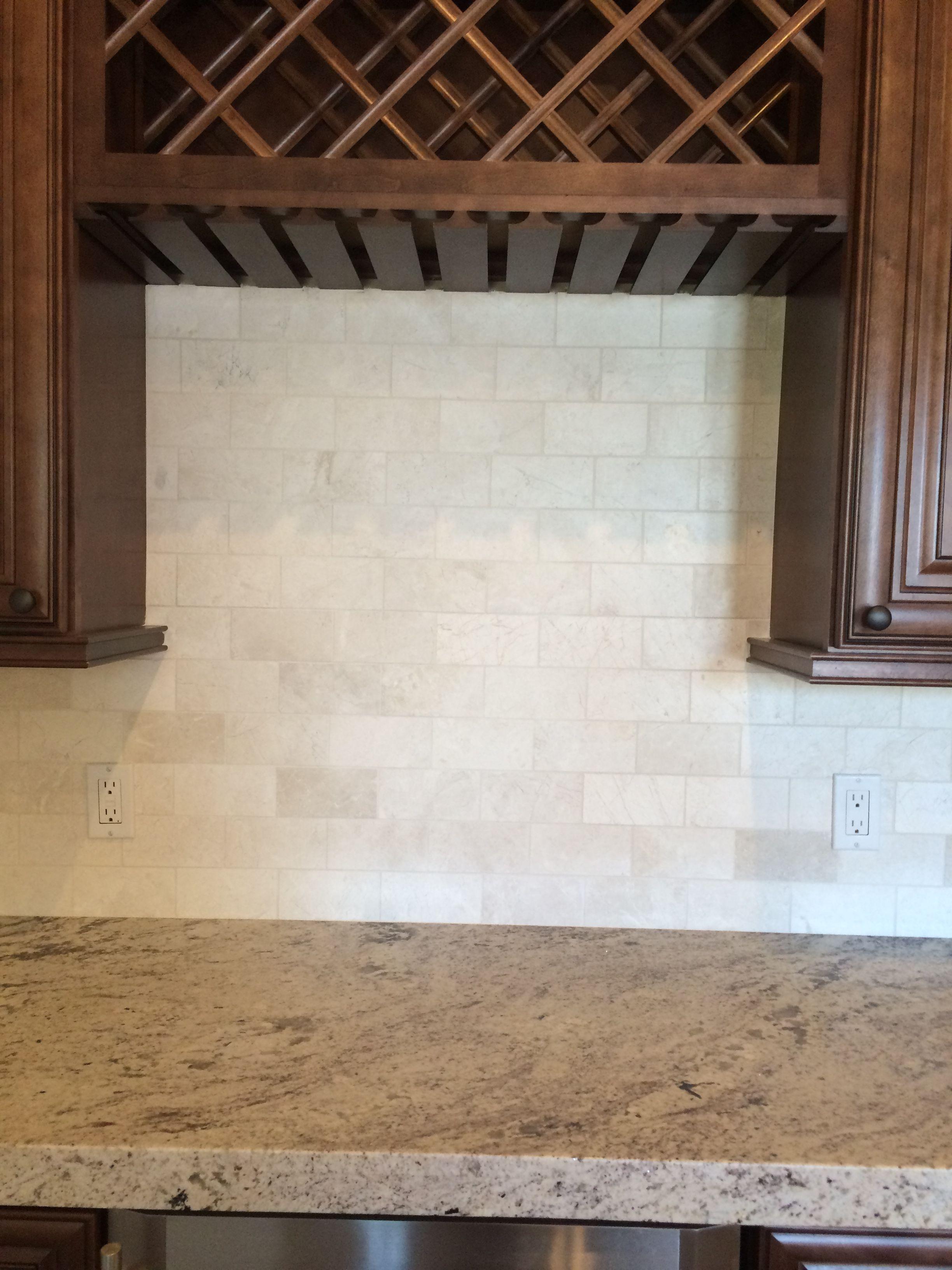 limestone subway tile backsplash