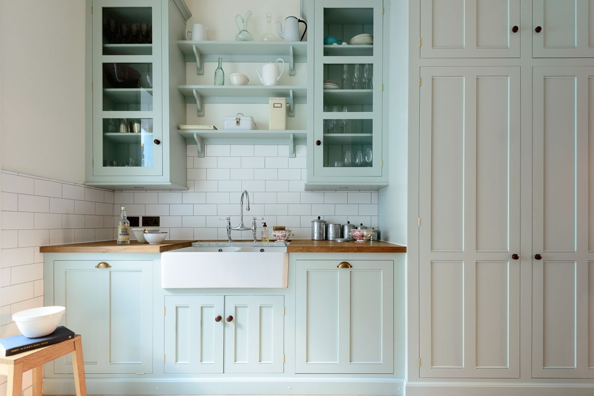 A lovely big larder cupboard, glazed tall wall cupboards and ...