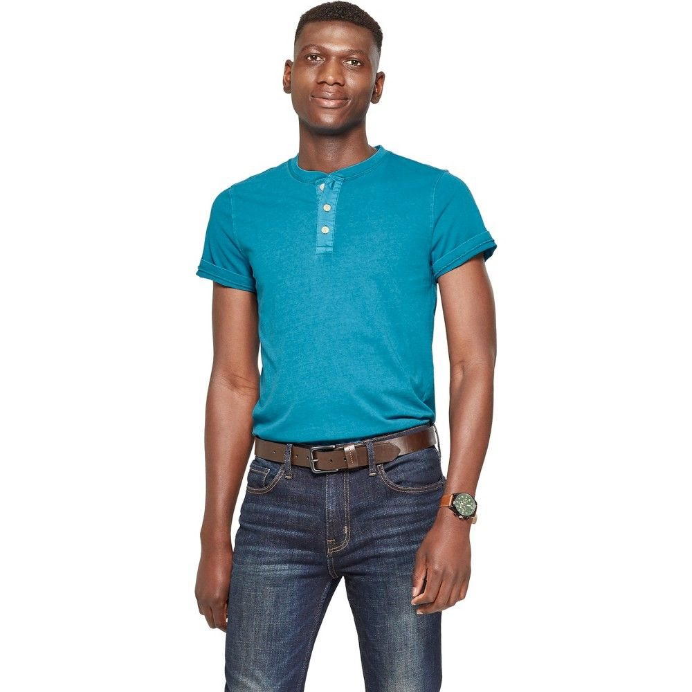 845d1cea23 Take your casual style up a notch with this Standard Fit Short-Sleeve  Henley Shirt from Goodfellow and Co. Crafted in a design that you can style  tucked in ...