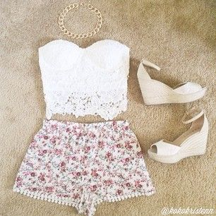 White top & floral bottoms. Super cute. But I don't like the shoes.
