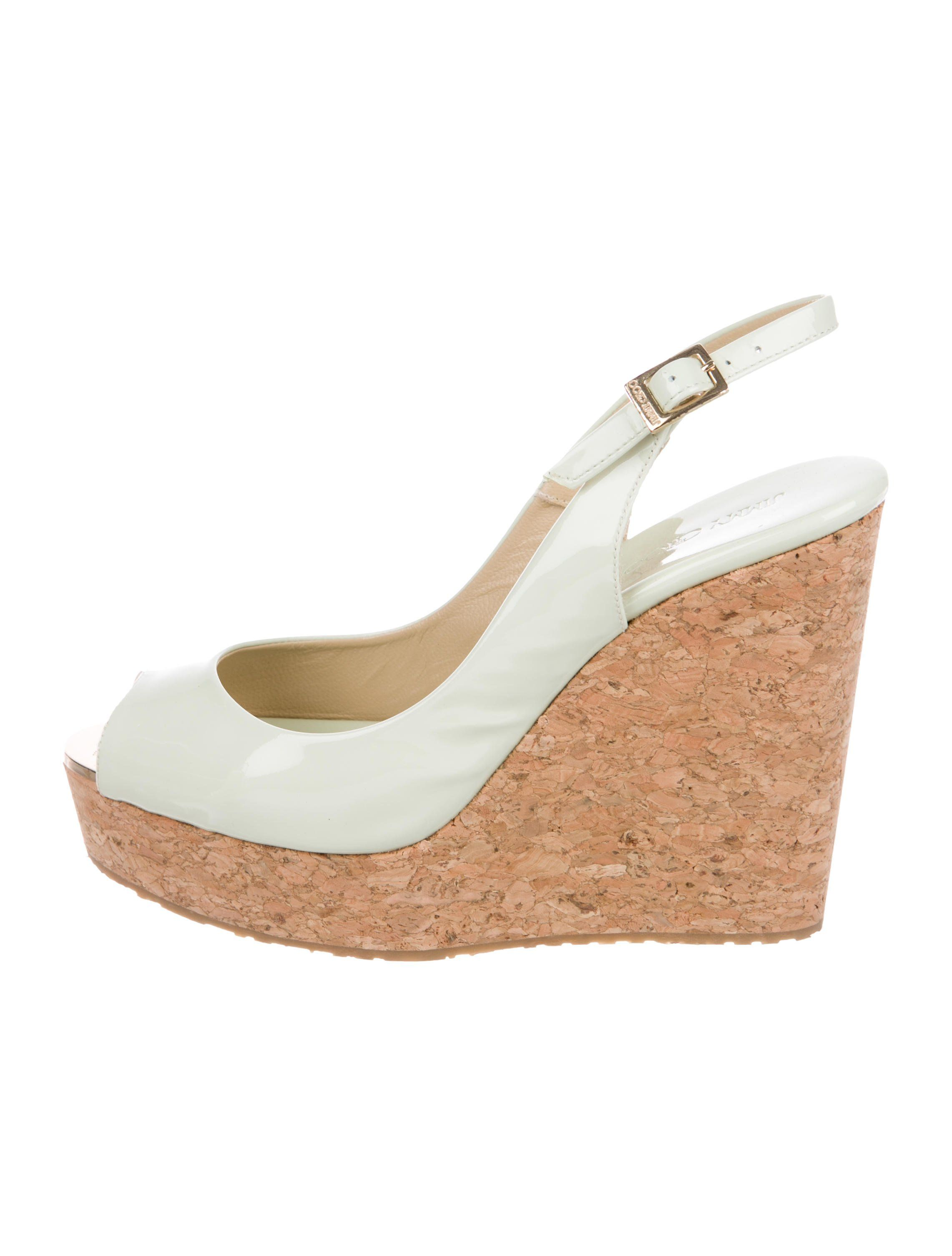 6721b158d9 Mint patent leather Jimmy Choo platform wedges with peep-toe, cork covered  wedges and slingback buckle closure. Includes box and dust bag.