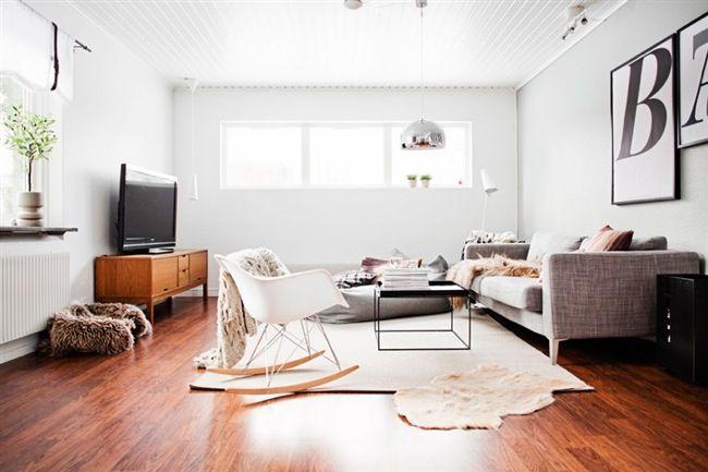 Scandinavian living room with dark wooden floor Decorating