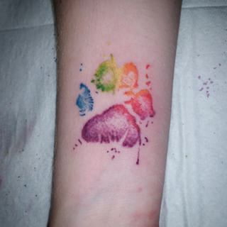 Rainbow Paw Print Tattoo