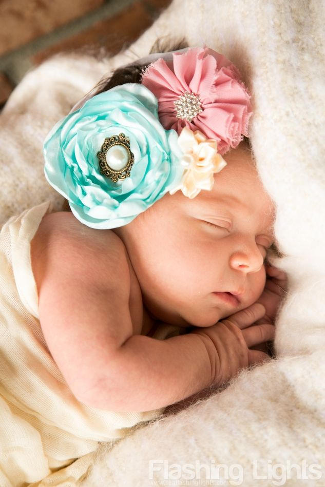 Newborn, baby girl, beautiful flower headband, baby in a basket, sleeping newborn