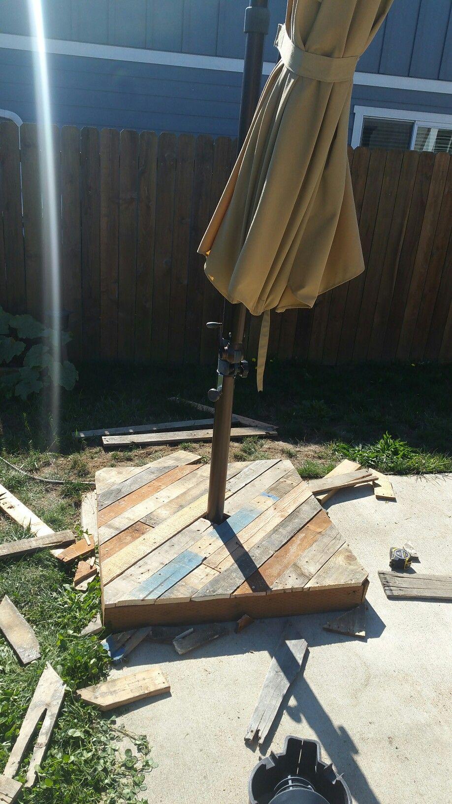 Umbrella base from up cycled pallet wood.   Backyard ...
