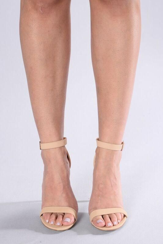 - Available in Black and Nude - Open Toe - Ankle Strap - Lightly Padded Insole - 4 Inch Heel
