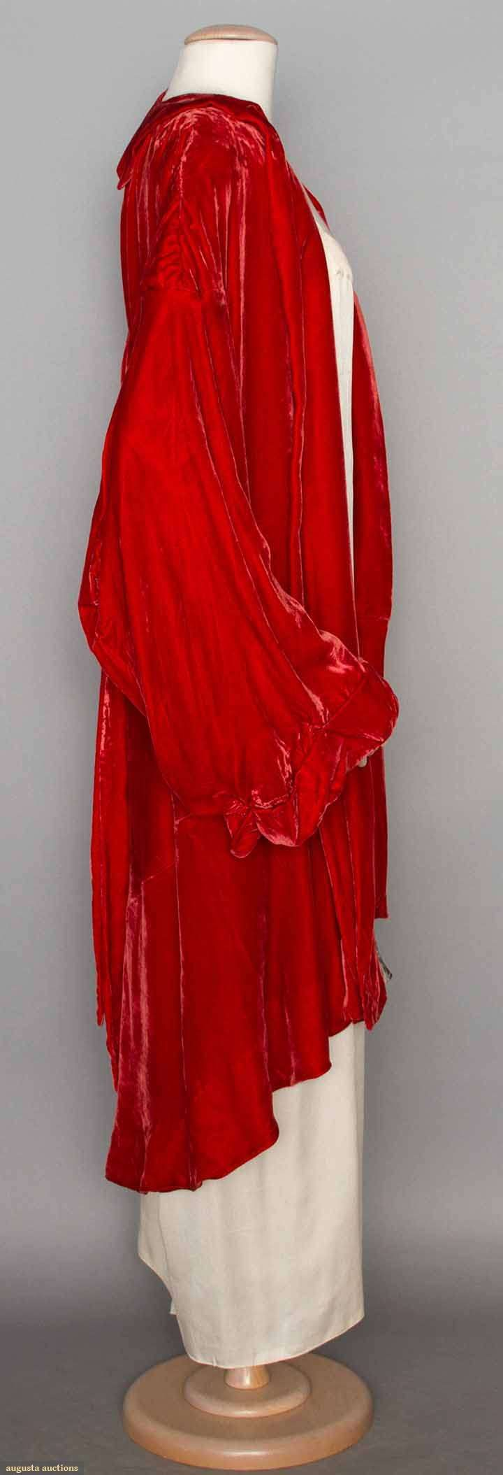 LUCILE PARAY EVENING COAT, PARIS, c. 1930. Coral silk velvet, bell shaped sleeve, asymmetrical hemline, lined in coral silk & white floral printed chiffon, CB tie panels, labeled. Sideway