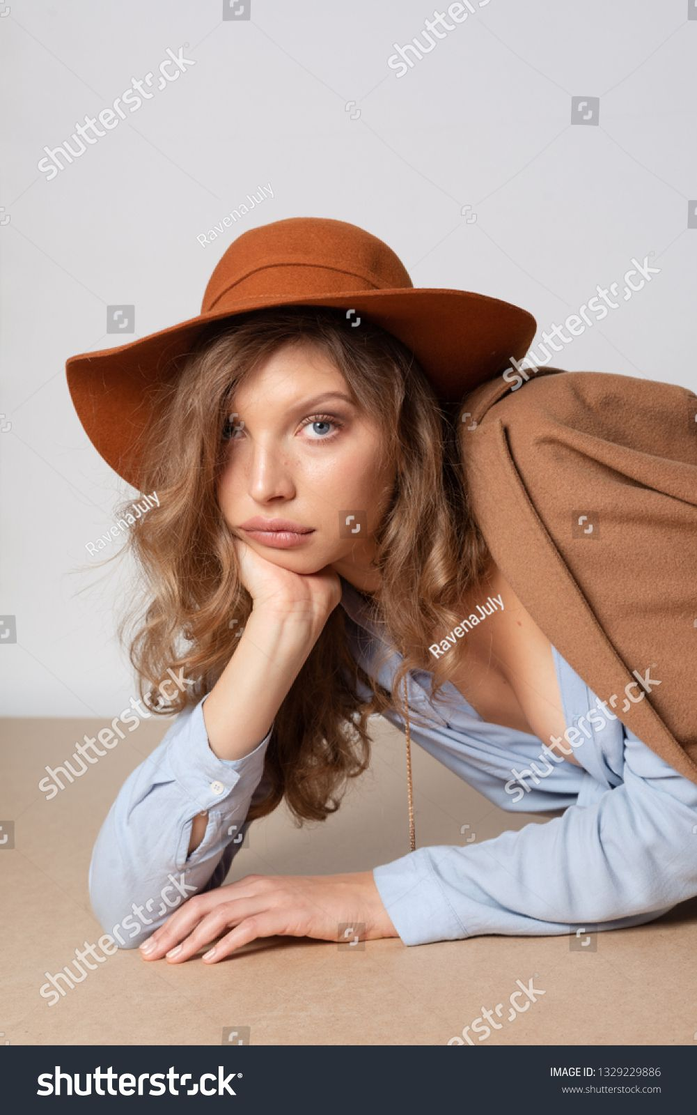 Fashion portrait of beautiful smiling girl with curly hair and big lips in a hat posing in studio on white background. Model test portrait. Natural young beauty #Sponsored , #ad, #hair#curly#lips#big