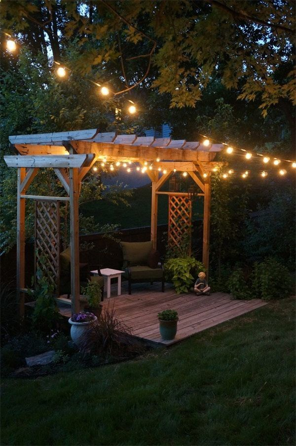 Pergola and string lights our backyard simple decking and pergolacould be strong enough for a swing