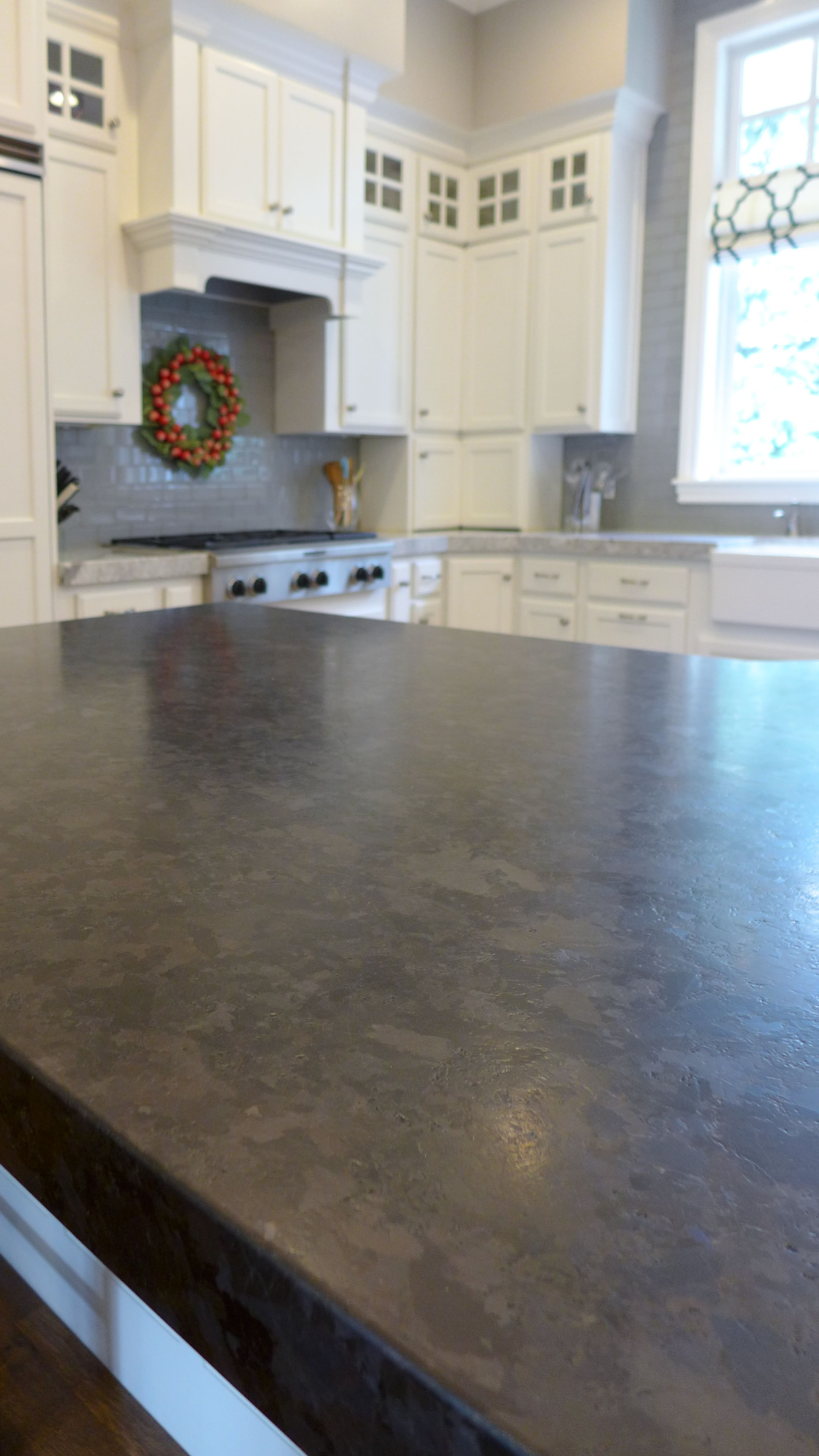 leathered Marron Cohiba granite kitchen island. | Countertops ...