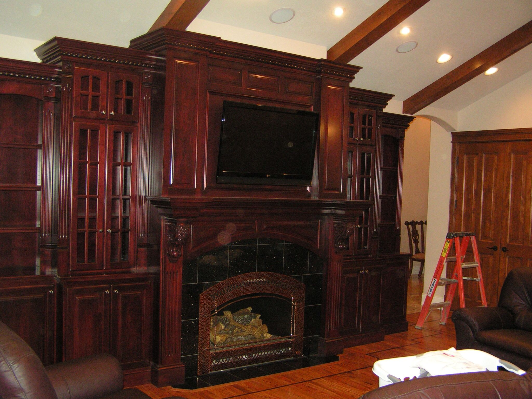this is a very elaborate cherry entertainment center and fireplace