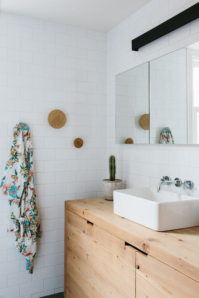 subway tiles are such a clean look for a modern bathroom and easy to clean also love the natural wood vanity and sink
