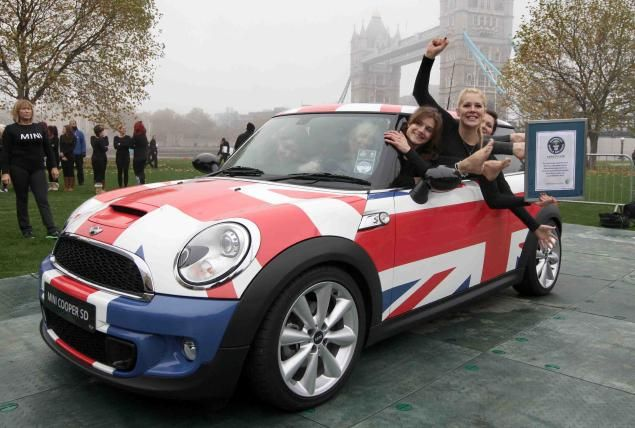 How Many People Can Fit Into A Mini English Group Breaks World Record With 28 Women Mini Cooper World Records Mini Cars