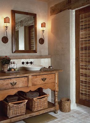 wall treatment, furniture made into vanity, rustic light fixtures, baskets, beam across door