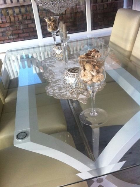 Beautiful Modern Glass Top Dining Table Long And Wideand Six Cream Leather Look Chairs