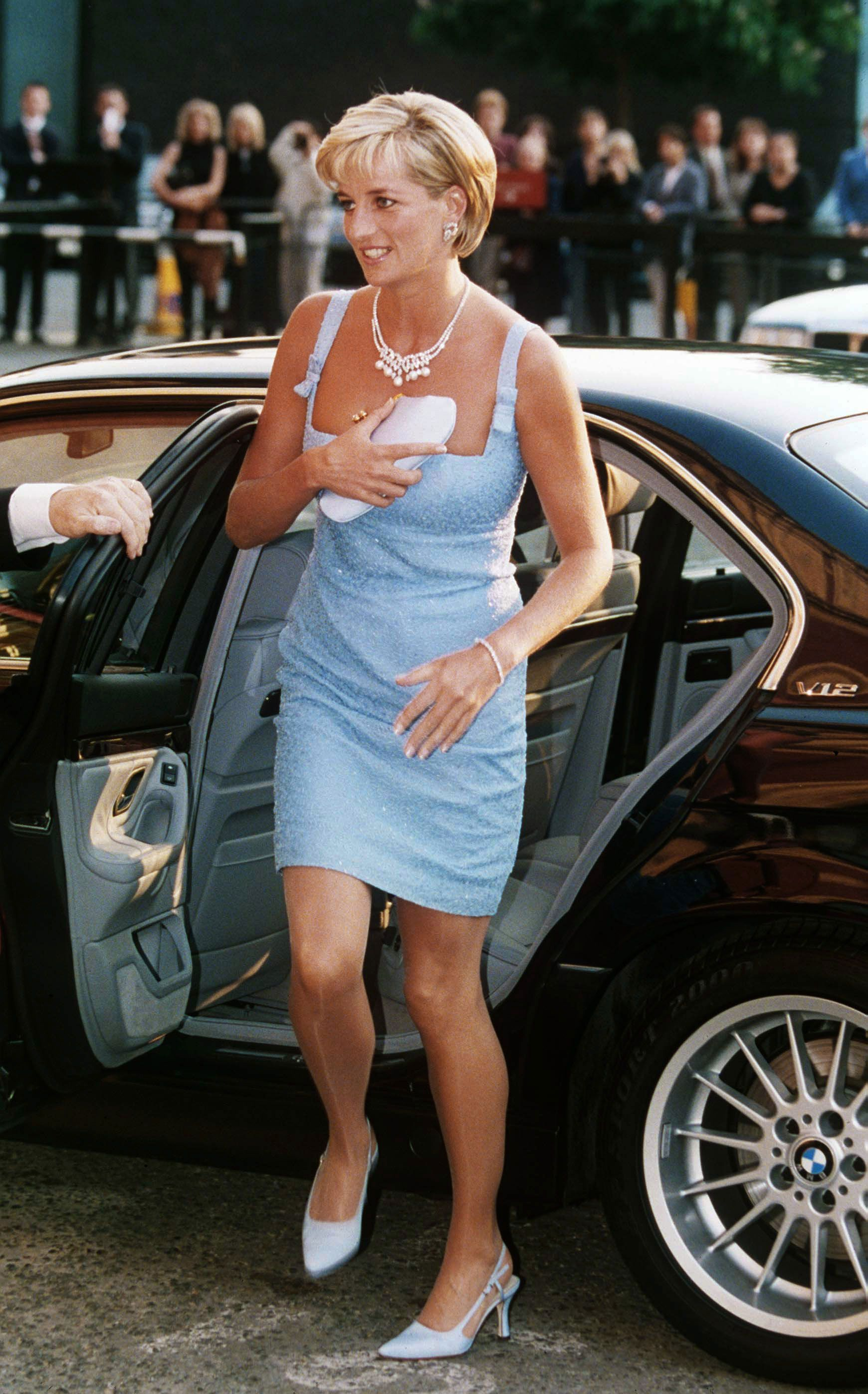 Just months before her death, Diana was photographed in an ice blue cocktail dress before catching a performance of Swan Lake at Royal Albert Hall in London. It was at this time that Diana was seeing Dodi Al-Fayed, with whom she died in the car crash in Paris, August 1997.   - MarieClaire.com