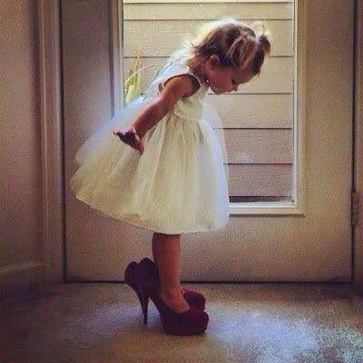 Little Girl wearing High heel shoes