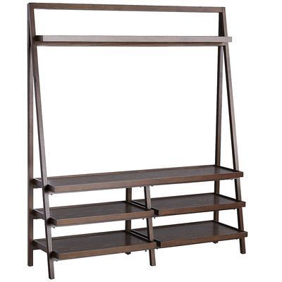 Our ladder-style TV stand provides lots of space for your electronics, of course, but also offers removable wine racks for bottle storage. Handcrafted of pine and engineered wood for durability and strength, Morgan is finished with hand-rubbed color for a lightly distressed effect and offers a clean, contemporary silhouette. Time to take a stand for your TV.