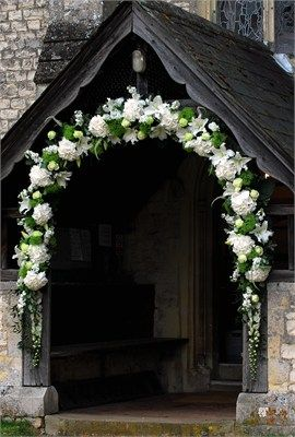 An Arch Decorating The Entrance To A Church Flowers And Stuff