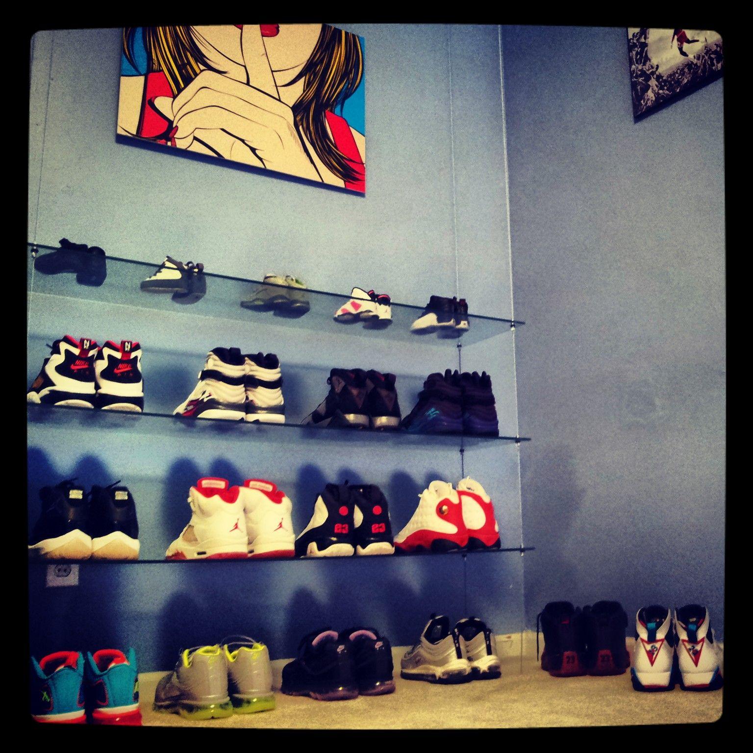 custom built floating glass shoe shelf