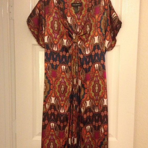 Women's dress Women's midi length v-neck short sleeve dress.  This multi-colored dress is a fuller cut w/back tie to make it more form fitting if you choose.  Very easy to wear, great for work or even dresser occasions.  Machine wash.  All reasonable offers considered. Lane Bryant Dresses Midi