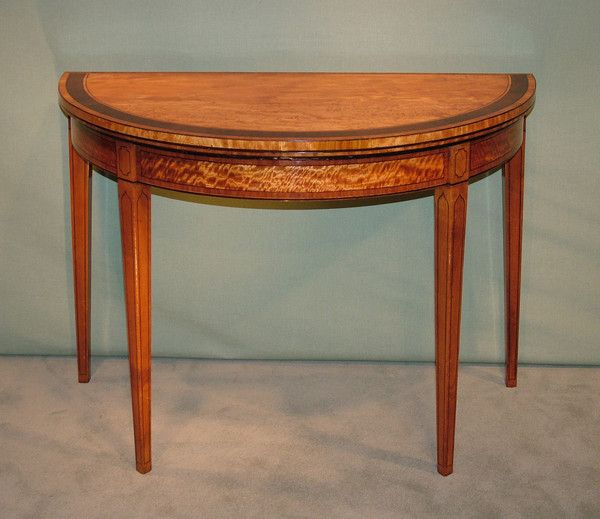 A Fine Late 18th Century Sheraton Period Figured Satinwood Half Round Card  Table, Having Tulipwood