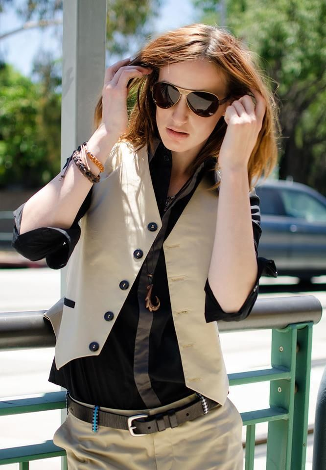 These vests are SO CUTE. You could do open neck button up, casual ...