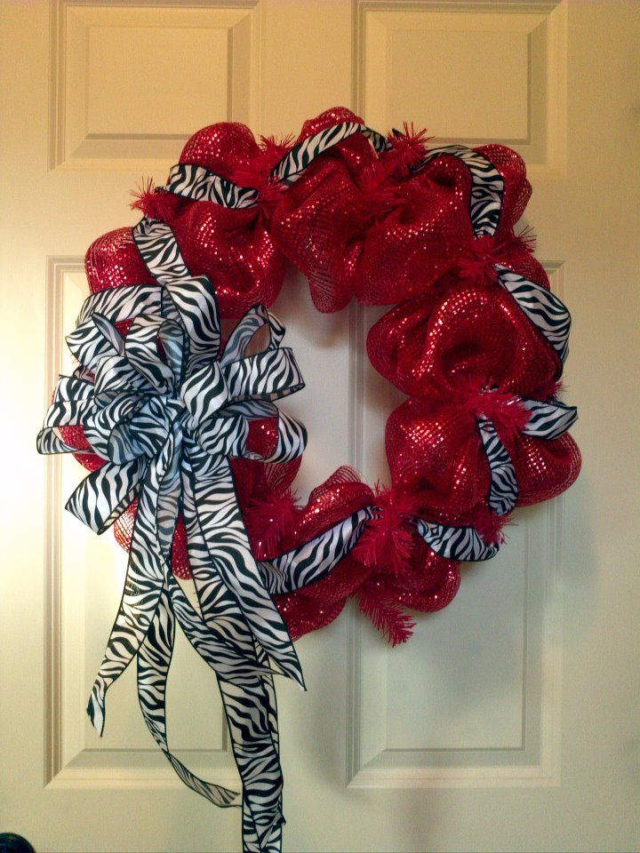 Deluxe red deco mesh with zebra print ribbon entwined and a huge bow!