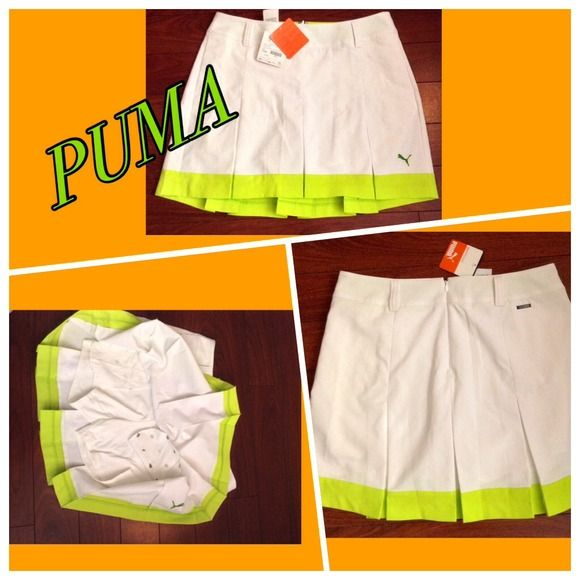 Adorable NWT puma tennis skirt! Fabulous color combo on this adorable NWT tennis skirt by Puma! Includes leggings underneath as well as pockets. Zipper in back and sweat wicking fabric! Puma Skirts