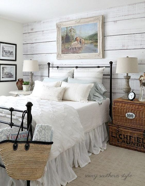 Farmhouse bedroom with barnwood accent wall, baskets side ...