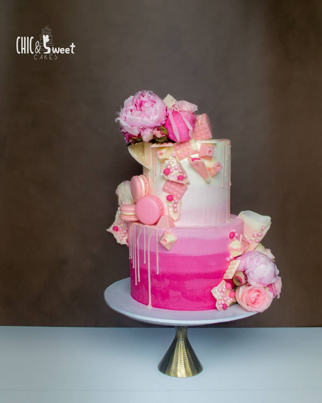 You are never too old for a fun pink cake. This gorgeous cake topped ...