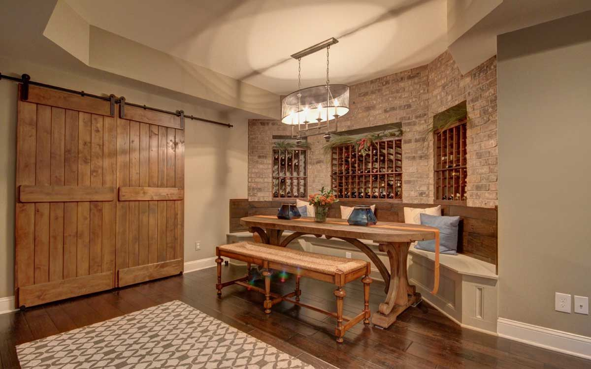 This swanky basement also includes a wine tasting nook with builtin