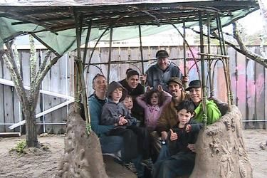 Bird Nest Bench... with that many people settled in there's no need for a rocket stove heater ;)