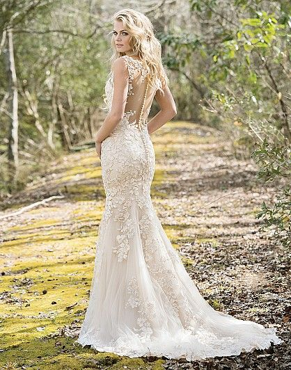 4a393cdd56 ... floral appliqués begin at the V-neckline and continue throughout the  body of this fit and flare gown. The floral appliqués also adorn the illusion  back ...